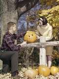 1960s Young Couple Man Woman in Autumn Woods Carving Halloween Jack-O-Lantern Pumpkin Photographic Print
