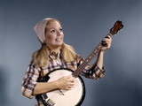1960s Young Blonde Woman Wearing Plaid Shirt Playing Banjo Singing Folk Music Photographic Print