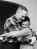 1950s-1960s Father and Son Hugging Indoor Photographic Print