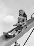 1950s-1960s Two Children Going Down Playground Slide Photographic Print