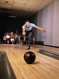 1960s Man in Good Form Releasing Bowling Ball Down Lane Wife Woman 2 Kids Behind Him Photographic Print