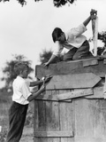 1930s Pair of Boys Building Shack One Nailing Board to Side One on Roof with Saw Photographie
