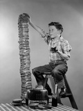 1950s Boy Eating Jelly Toast Sitting on Ladder Stacking Up Tall Pile of Toast from Toaster Photographic Print