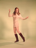 1960s Woman Dancer in Tan Dress and Boots White Fishnet Stockings Photographic Print