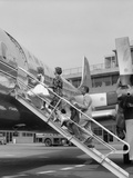 1950S Family Boarding Propeller Airliner by Climbing Gangway Stairs at Airport Photographic Print
