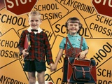 1950s Girl and Boy with Book Bag and Books Holding Hands Together in Front of School Photographic Print