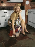 1960s Tired Housewife Sitting on Top of Laundry Basket in Kitchen Photographic Print
