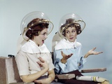 1960s 2 Women Sit under Beauty Salon Hair Dryers Clear Helmets Hoods Curlers Talking Gossip Photographic Print