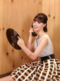1950s Teenage Girl Talking on Telephone and Holding Lp Record Photographic Print