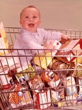 1960s Happy Baby Sitting Inside Shopping Cart Full of Groceries Photographic Print