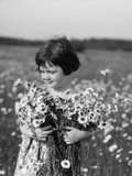 1920s Girl in Meadow Holding Bunch of Daisies Photographic Print