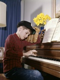 1960s-1970s Impatient Annoyed Looking Boy with Baseball Cap and Glove Practicing Piano Lesson Photographic Print