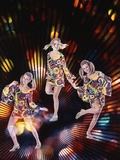 1970s Triple Exposure of Young Woman in Patterned Dress Dancing Through Strobe Lights Photographic Print