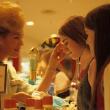 1970s Teen Girls at Make Up Counter in Store Having Eye Shadow Applied Tested Photographic Print