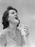 1940s Woman Gargling Medicine Holding a Glass Indoor Photographic Print