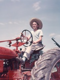 1950s Farm Boy Wearing Straw Hat and Driving Tractor Photographic Print