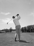 1950s-1960s Rear View Man Swinging Golf Club Photographic Print