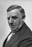 1930s-1940s Portrait of Gruff Older Man Businessman Salesman Character Winking Photographic Print