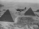 Army Supply Plane over the Pyramids Photographic Print