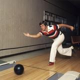1970s Man Stripe Shirt Flare Leg Pants Throwing Bowling Ball Down Lane Alley Photographic Print