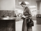 1950s-1960s Woman Handbag on Arm Gloves Filling Out Deposit Slip Bank Counter Photographic Print