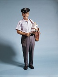 1970s Standing Full Length Portrait of Middle Aged Mailman Carrying Mail Bag Wearing Uniform Photographic Print