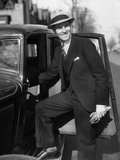 1930s Man in Suit and Hat Holding Gloves Stepping into Automobile Driver Seat Photographic Print