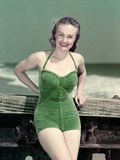 1940s Portrait Smiling Woman Wearing Green Velvet Bathing Suit Posing Leaning on Diving Board Photographic Print