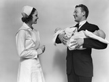 1930s-1940s Woman Nurse Talking with Man Proud New Father Holding Newborn Twin Babies Photographic Print