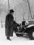 1930s Man in Hat and Raccoon Fur Coat Standing Foot on Bumper of Chevrolet Roadster Stalled Photographic Print