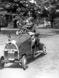 1930s Boy Driving Home Built Race Car Holding Steering Wheel Photographic Print