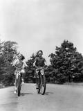 1940s Boy Girl Riding Bikes Down Country Lane Photographic Print