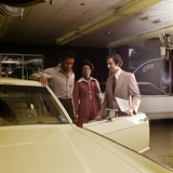 1970s African-American Couple with Salesman Automobile Showroom Photographic Print