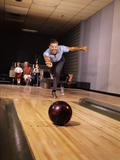 1960s Man Throwing Bowling Ball Down Alley as Family Watches in Background Fun Dad Father Photographic Print