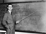 1930s Man Teacher Looking at Camera with Pointer at Blackboard Photographic Print