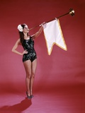 1960s Young Woman in Sequined Black Swimsuit Blowing Baroque Trumpet with Pennant Photographic Print