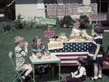1950s Girls and Boys in Business with a Lemonade and Snack Food Stand on the 4th of July Photographic Print