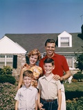 1960s Portrait Family Father Mother Two Sons Standing Together in Front of Suburban House Photographic Print