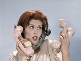 1960s Frustrated Young Redheaded Woman Trying to Answer Handle Five Telephone Receivers Studio Photographic Print