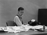 1930s-1940s Busy Man in Shirt Sleeves Behind Office Desk Working at Typewriter Smoking Cigarette Photographic Print