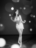 1960s Woman Dancing in White Fringed Halter Top Mini-Dress Skirt and Go-Go Boots Photographic Print