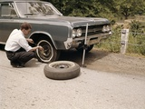 1960s Man Changing Flat Tire on Car at Side of Rural Road Car Jack Tools Tire Iron Photographic Print