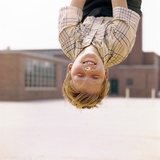 Red Haired Boy Hanging Upside Down in Elementary School Yard Photographic Print