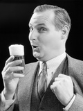 1930s Man Holding Full Foamy Glass of Beer Making a Funny Face Photographic Print