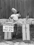1930s-1940s Boy at Lemonade Stand Shouting into Megaphone Photographie