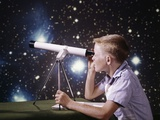 1960s Composite Boy with Telescope on Table Looking at Night Sky with Stars Galaxy Nebula Photographic Print