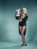 1960s Young Woman in Stage Magician Coat and Short Shorts Pulling Rabbit Out of Top Hat Photographic Print