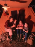 1960s-1970s Grandfather Telling Scary Story to Boys by Tent at Night Campsite in Shadows Reproduction photographique