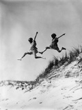 1920s-1930s Two Girls Midair Jumping Off of Beach Sand Dune Photographic Print