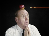 1960s Anxious Business Man Looking Up at Arrow Heading Towards Apple Sitting on Top of His Head Photographic Print